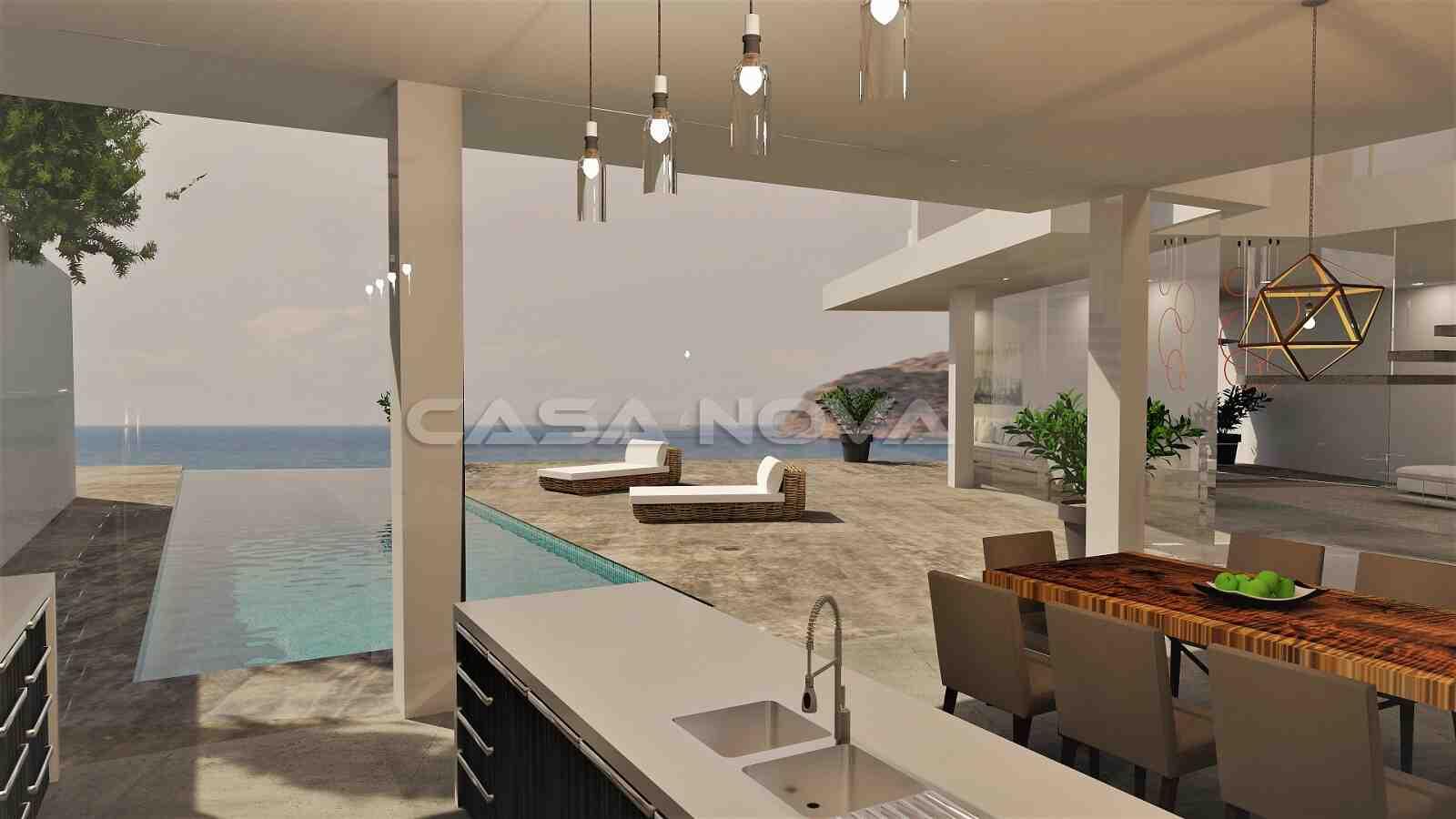 Überdachte Terrasse mit Sommerküche und Blick auf den Pool