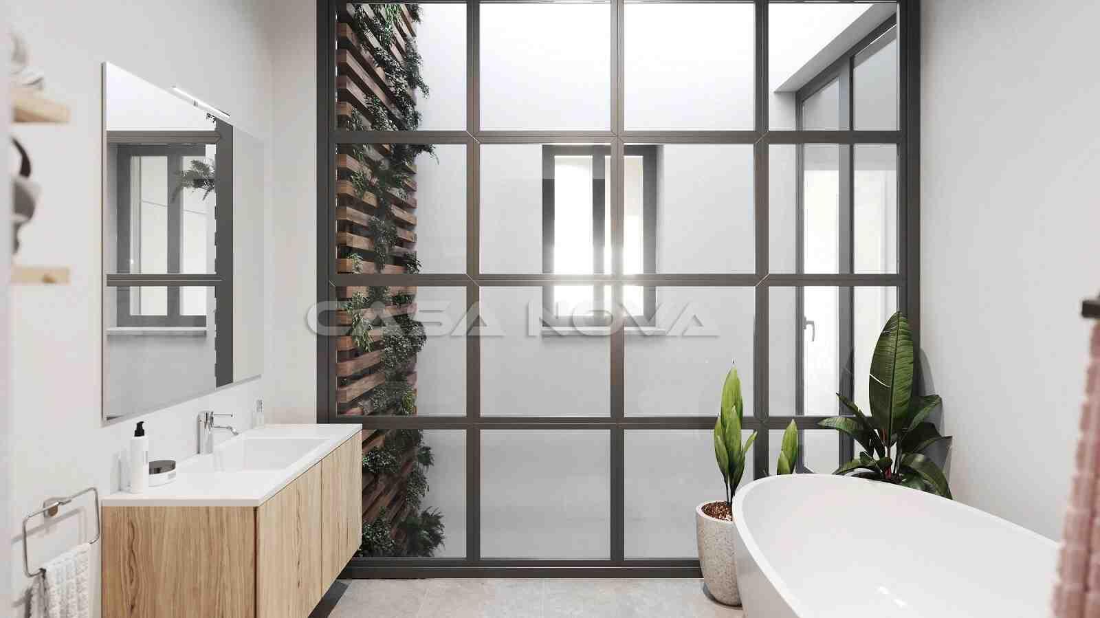 Avantgardisches Badezimmer mit großen Fensterelementen